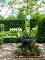 urn in the white garden